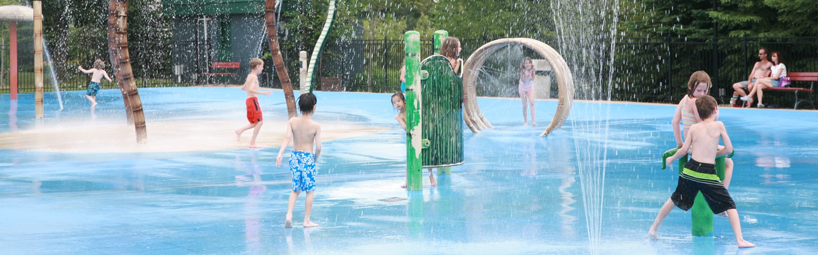 Children playing at splash pad
