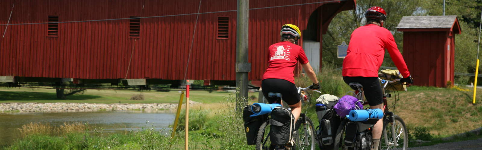 Biking towards covered bridge