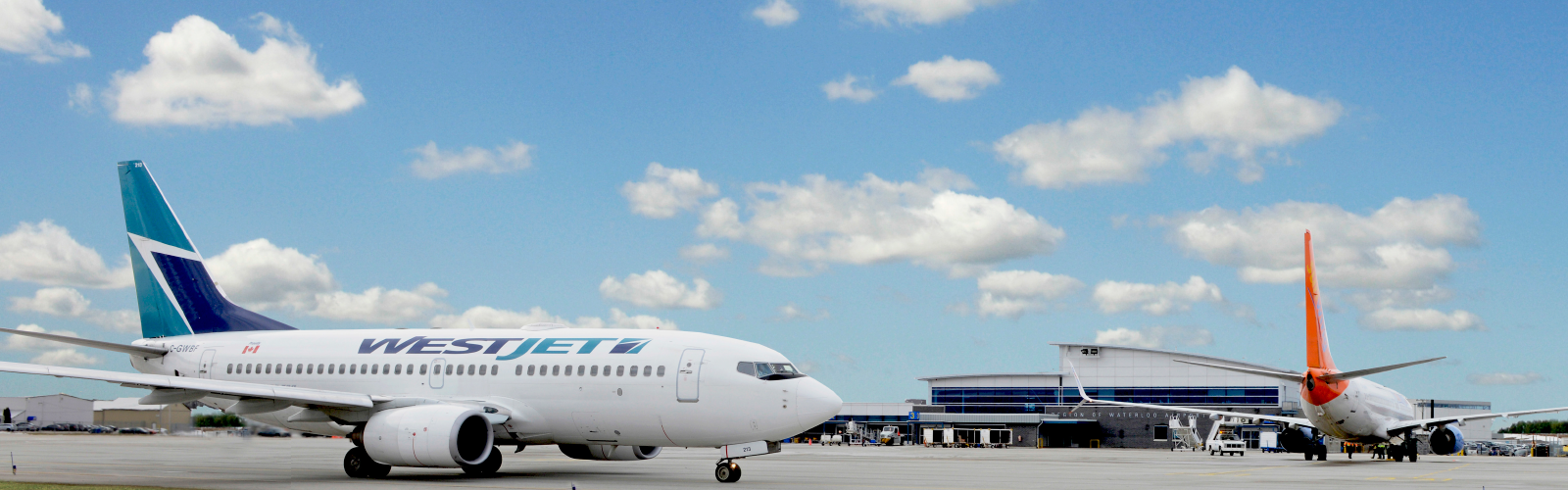 Picture of a WestJet Plane at the Region's airport