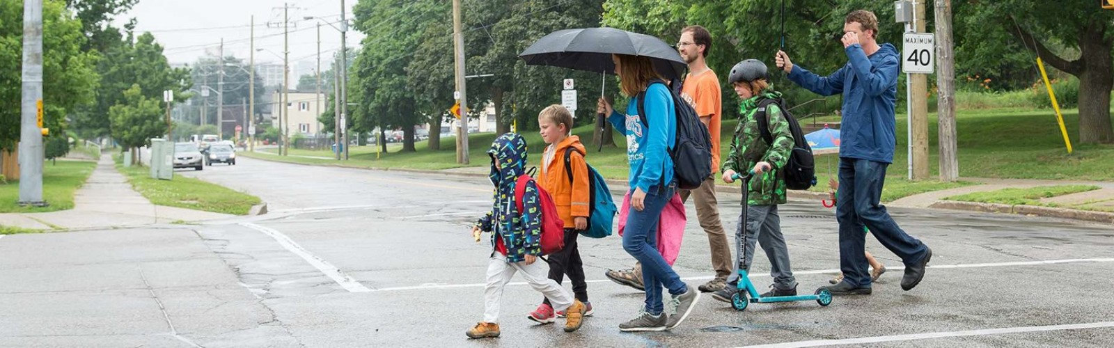 Children and adults walking to school