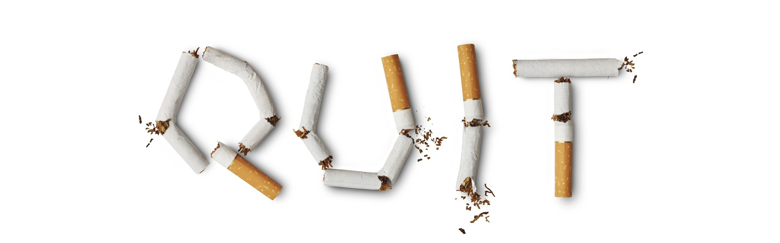 "The word ""quit"" spelled using broken cigarettes"
