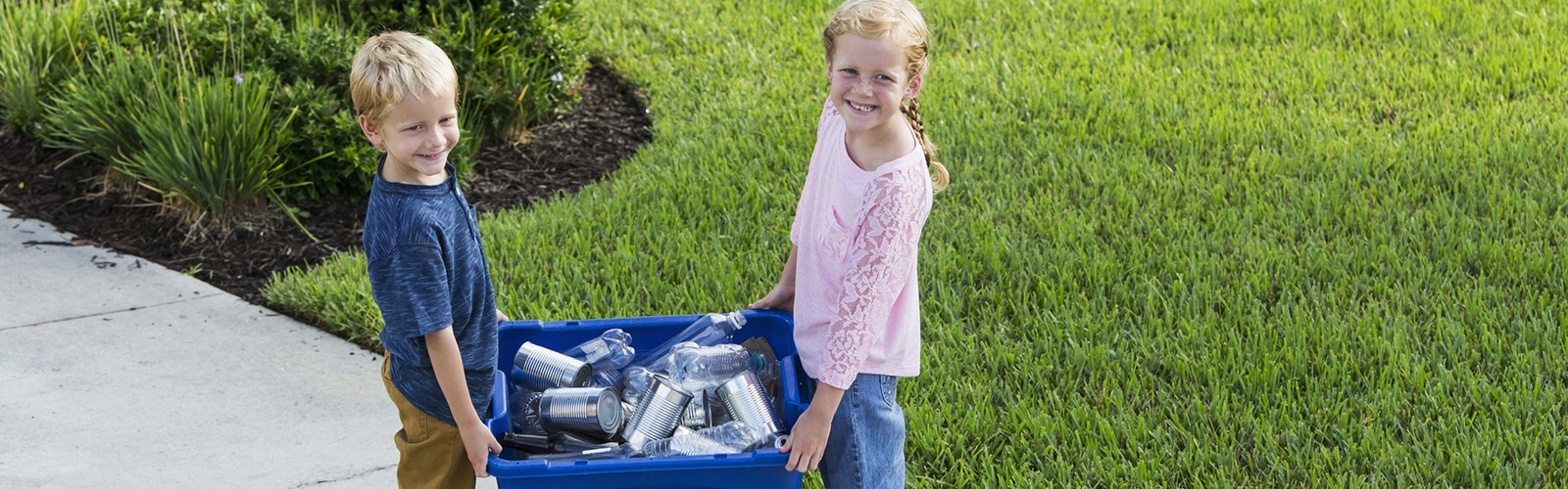 Kids taking blue box to the curb