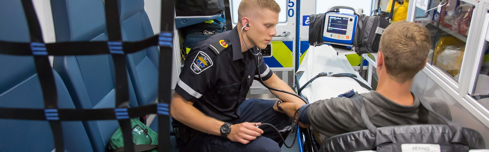 Paramedic treating a patient