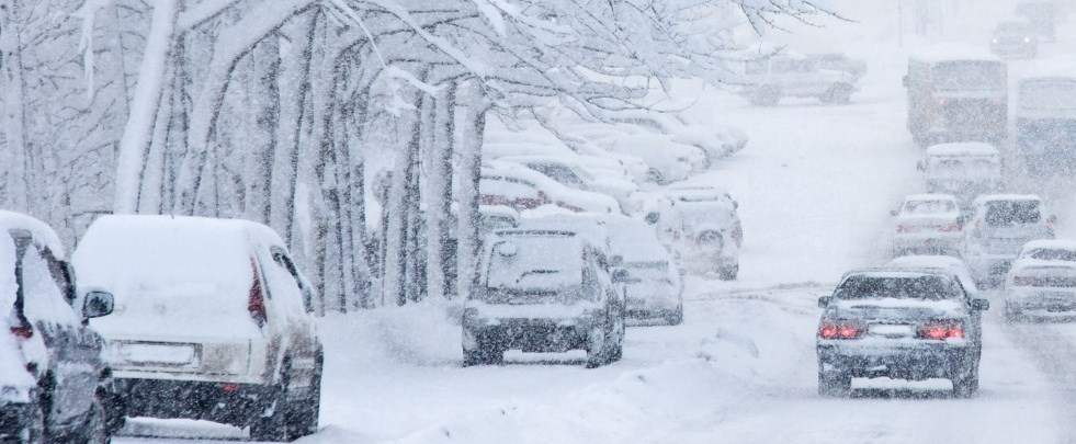 Image of vehicles driving through winter storm with poor visibility