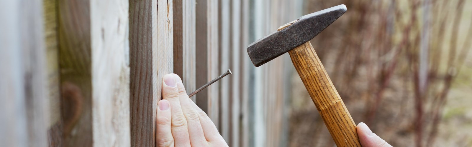 Hammer and fence