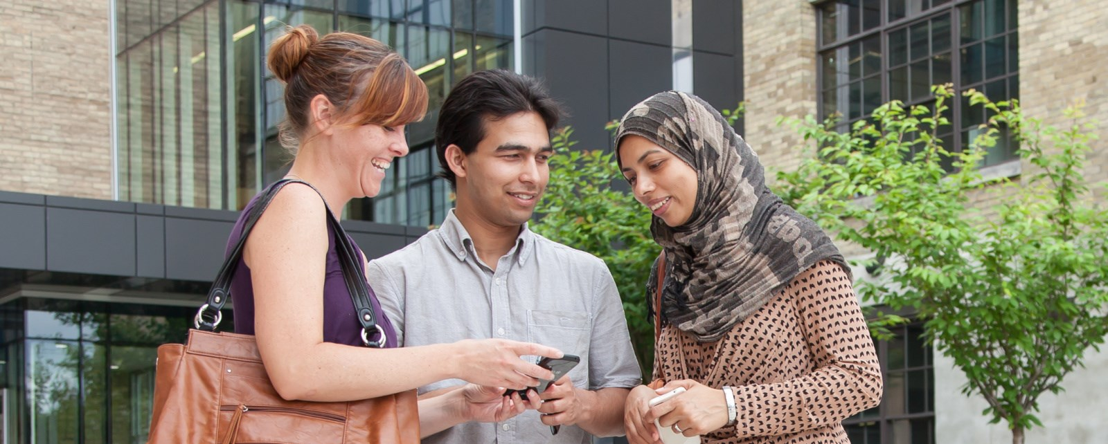 Image of young adults looking at mobile phone
