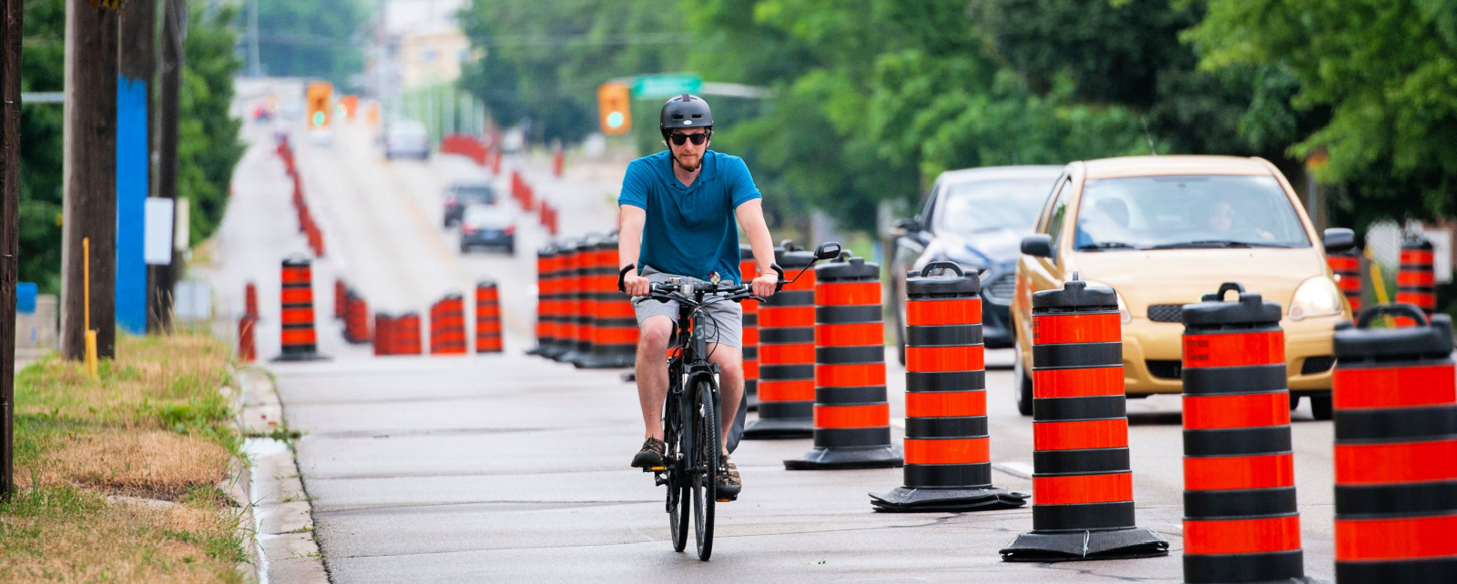 Cyclist riding in temporary bike lanes
